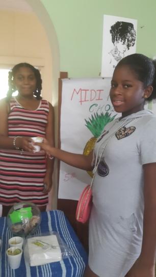 Kerreece Arjoon, Mo Girls-POS Mini Mogul purchases a cup of pineapple chow.