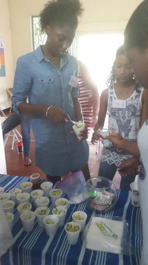 Jada Cunningham (Major Mogul) and Shael Galera (Mini Mogul), patrons of the MMCC add condiments to their pineapple chow.