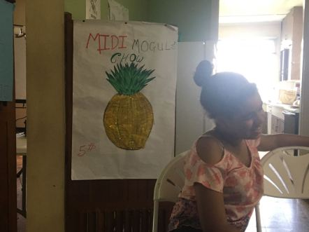 Gabby Bundbury, designer of the Midi Mogul Chow logo poses bashfully in front of her masterpiece!